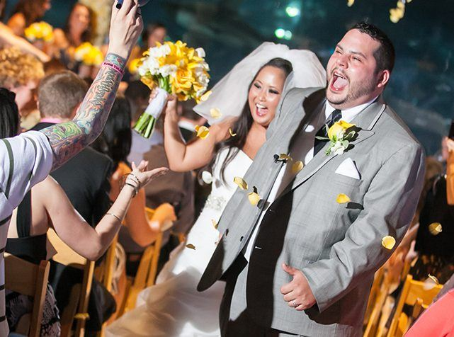 Happy couple who are walking down the aisle